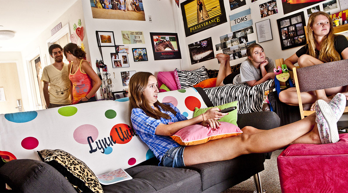 Students sit in their visit in their dorm room in E.M. Lynn Residence Hall.