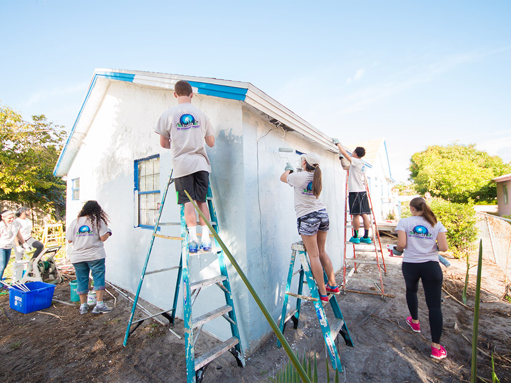 Students at Lynn paint a Delray home.