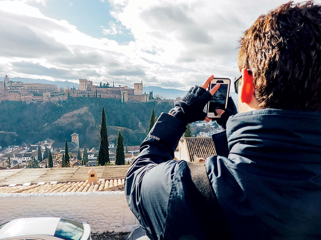 Student taking photo in Spain