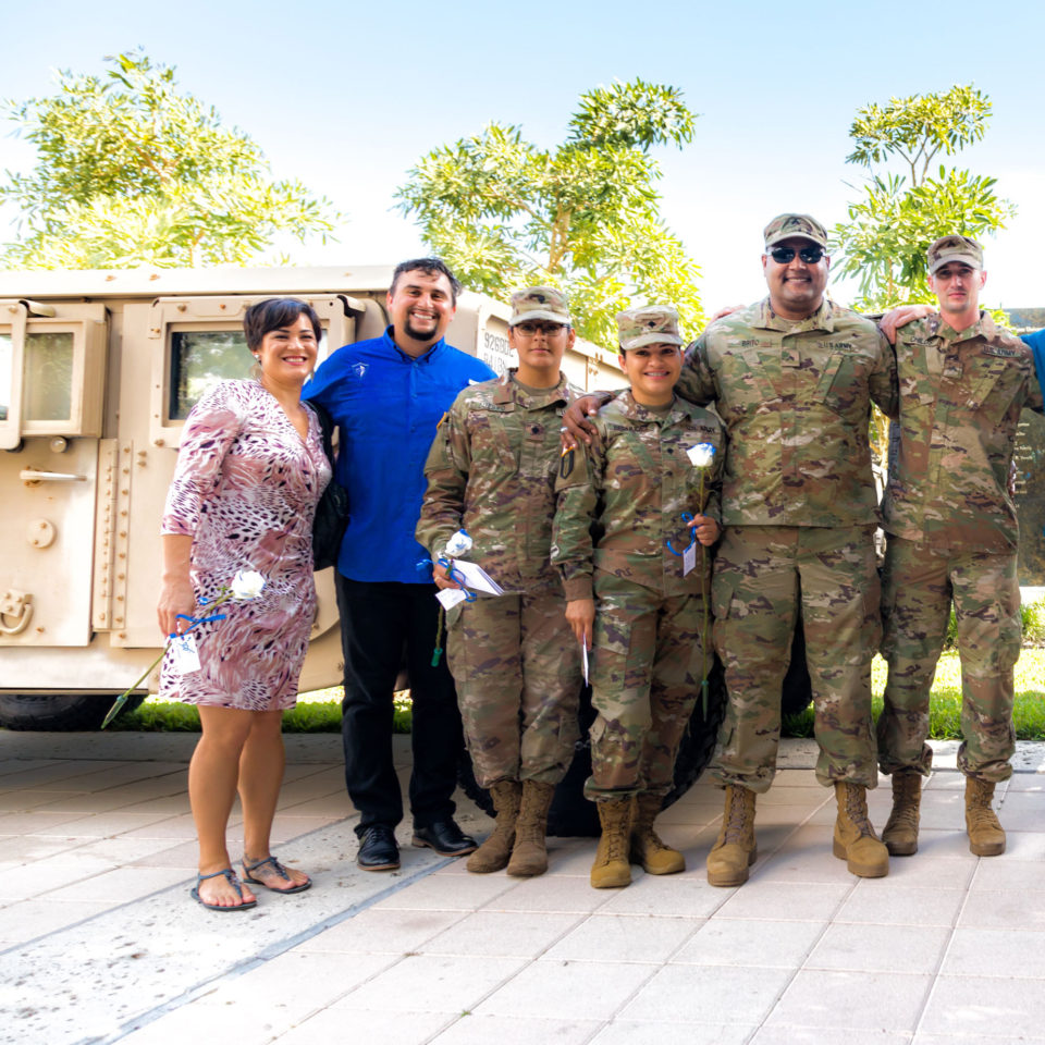 Lynn University President Kevin M. Ross is joined by military veterans and active-duty soldiers.