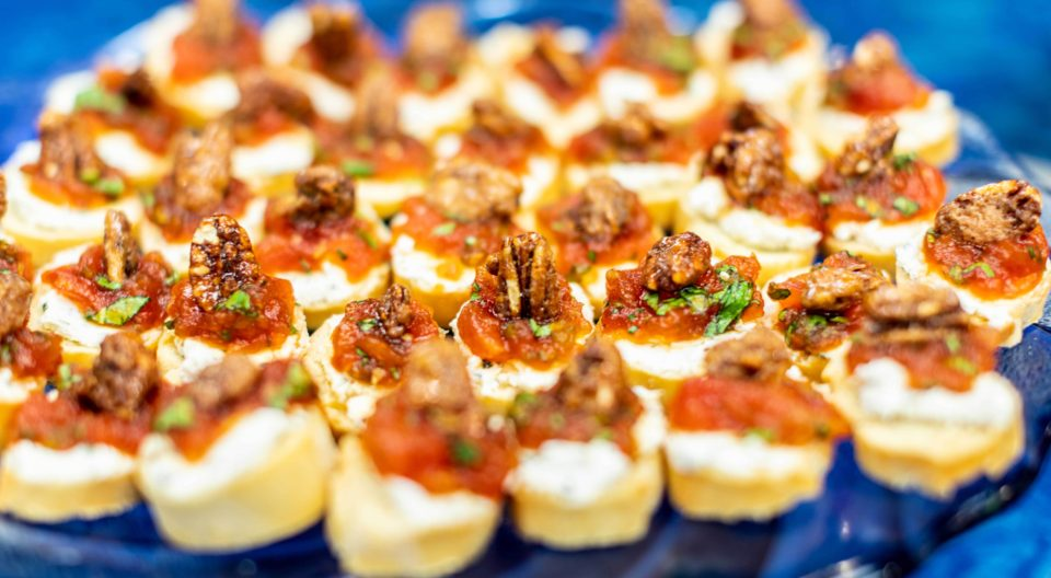 Bruschetta with tomato jam, goat cheese and candied pecans