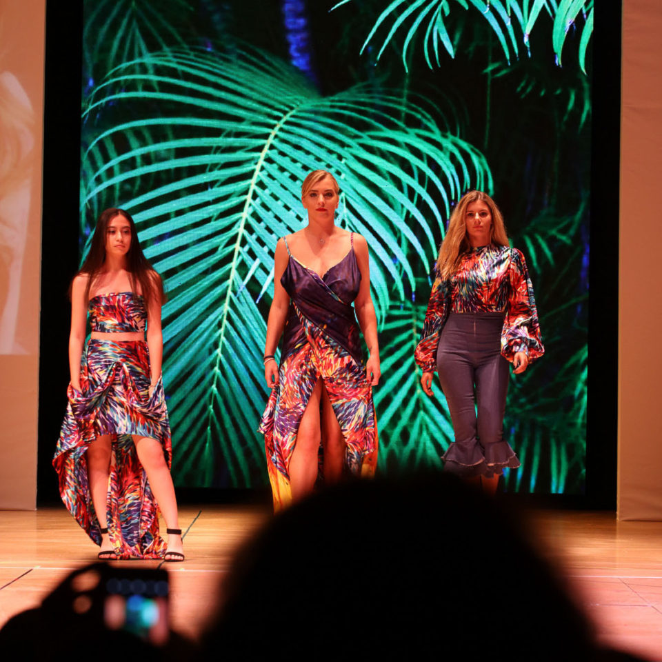 Three students show off jungle-inspired fashion