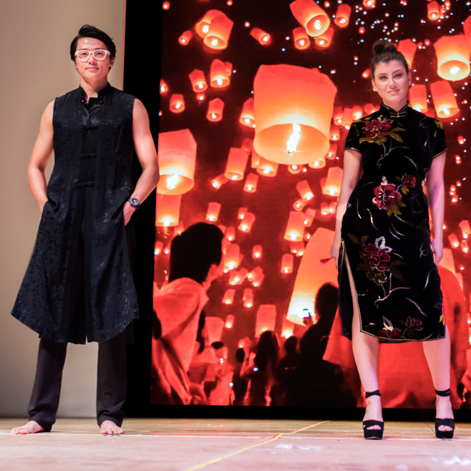 A male and female student show off Japanese designs