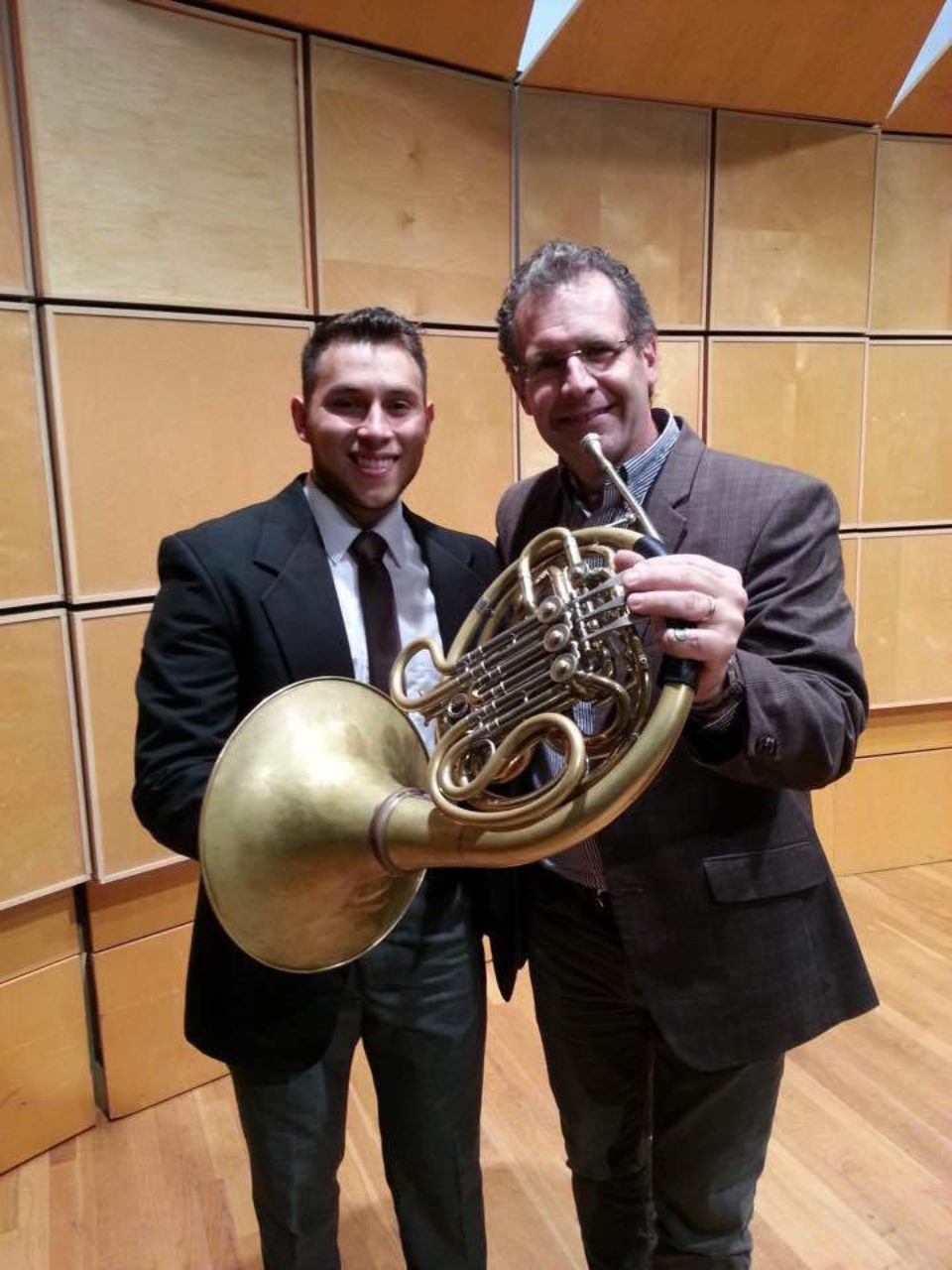 Valverde and Miller holding a French horn