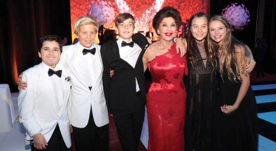 Christine Lynn posing with younger guests at 70th birthday