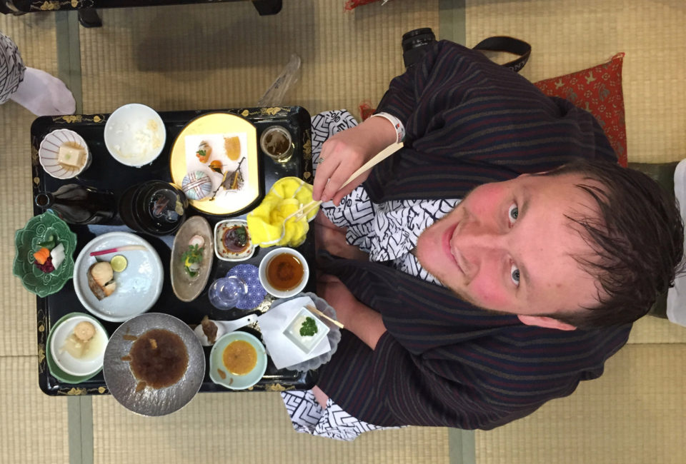 student sitting in front of a variety of Japanese dishes