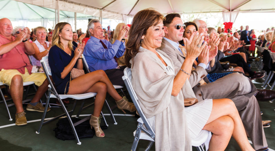 Crowd clapping at University Center groundbreaking