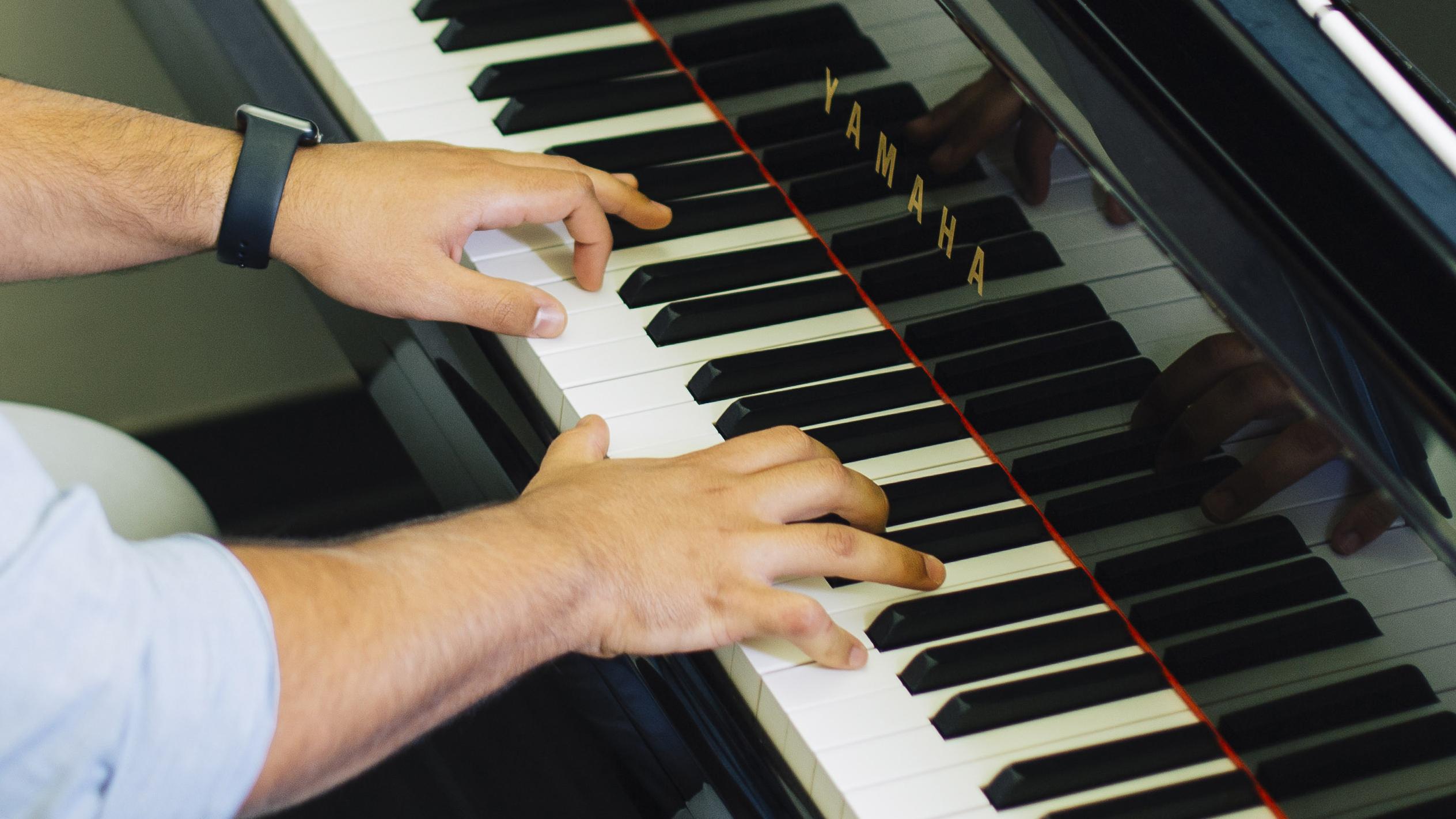 Alfredo plays the piano