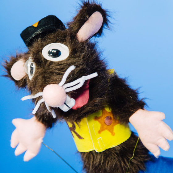 Mouse puppet dressed as a sheriff.