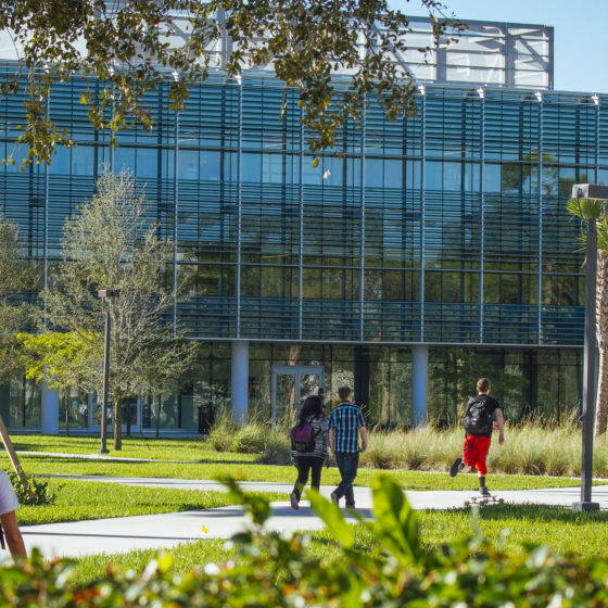 Students walking toward the International Business Center on the Lynn University campus.