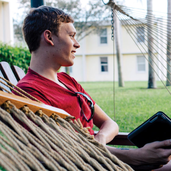 Student relaxing at the courtyard