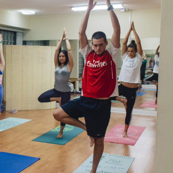 Students practice yoga at Lynn.