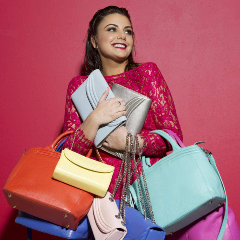 Lauren Cecchi with her designer handbags
