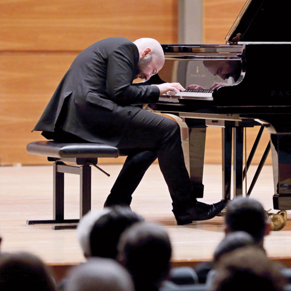 Alessandro Deljavan plays the piano at Lynn's Conservatory of Music.