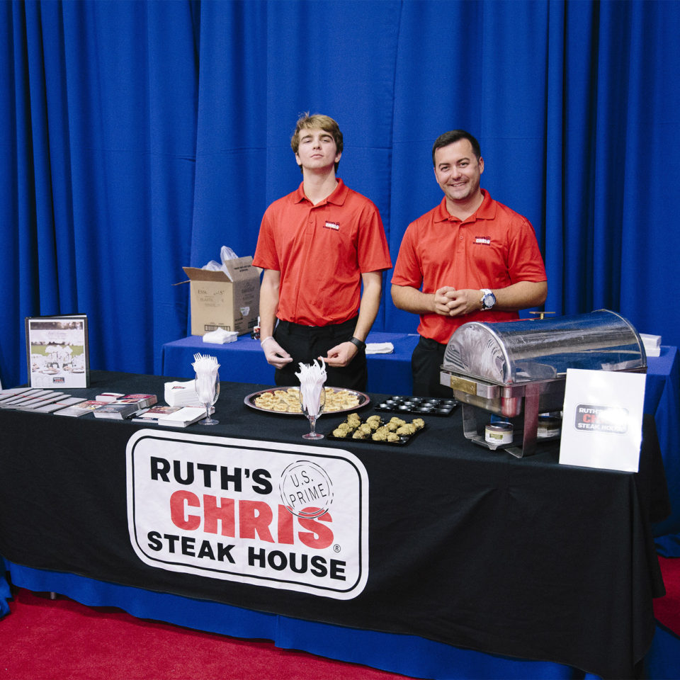 Ruth's Chris Steakhouse employees sponsor an event for the Fighting Knights.