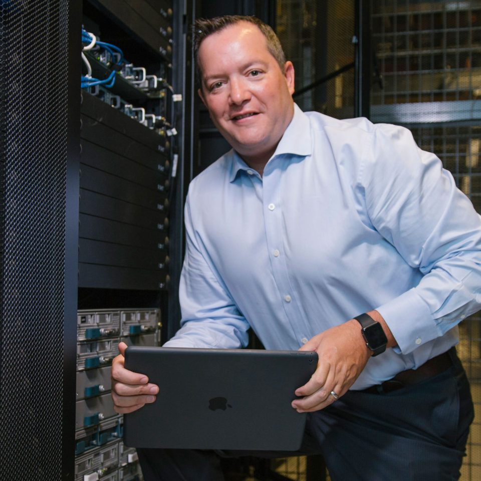Chris Boniforti poses at Equinix, Lynn's data storage partner facility.