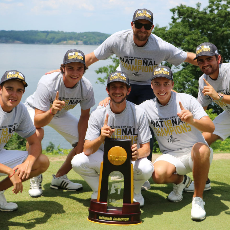 The 2017-18 National Champion men's golf team with Coach Andrew Danna