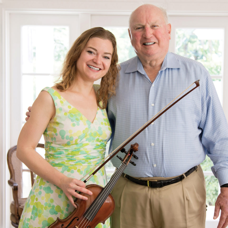 Jim Birle standing with Yasa Poletaeva and the violin he bought her