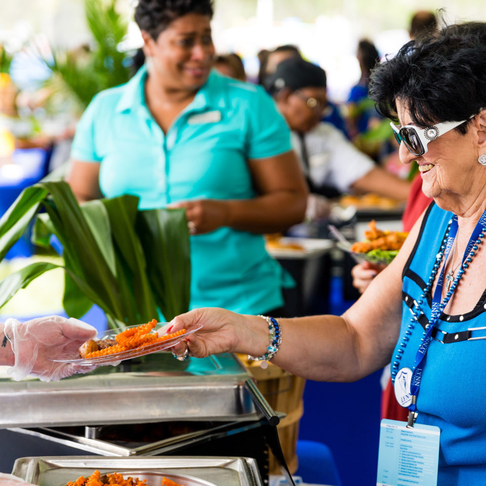 Parents being served food at Parents and Family weekend 2017