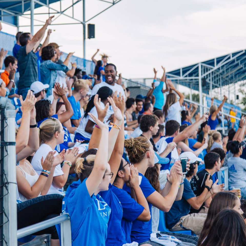 Fighting Knights fans cheer at Bobby Campbell Stadium.