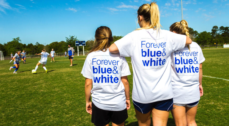 "Students pose with ""Forever blue and white"" t-shirts"
