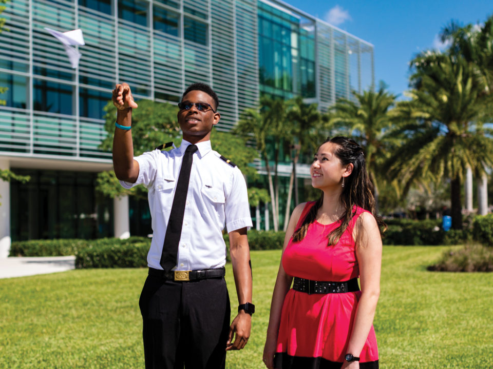 Student with donor flying paper airplane