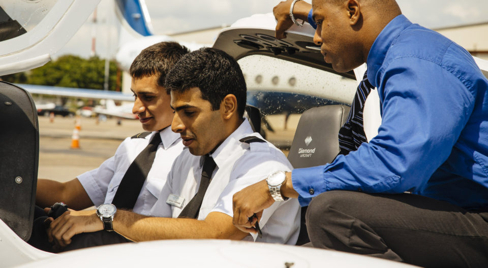 Instructor gives students cockpit training in the MBA in aviation management program.