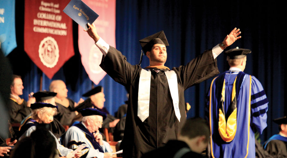 Student walks across the stage at Commencement