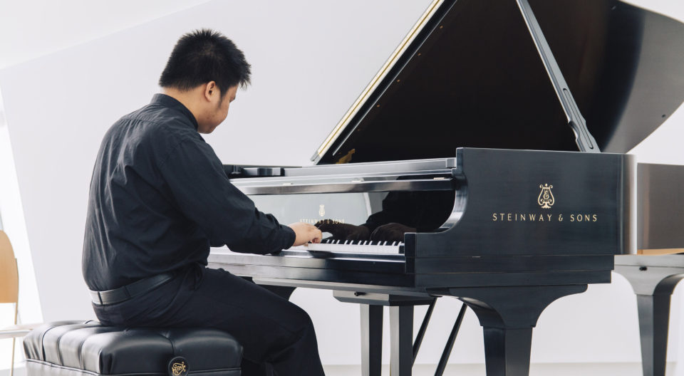 Student gets advanced training to earn his piano master.