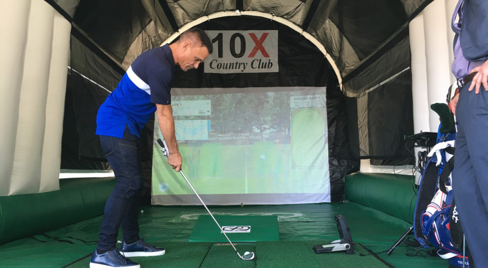 Lynn student creates a golf simulator and lets others play.