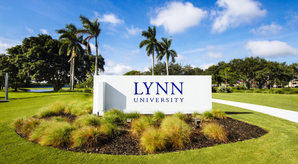 Visitors pass this Lynn University sign at the front entrance on their way to the Admission office.