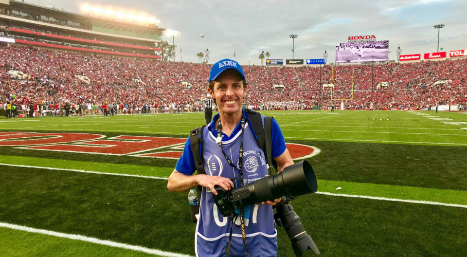 2006 Alumni Justin Cohen poses on the field at the Rose Bowl Game that he photographed in Pasadena, Calif.