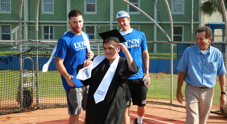 "Ari Cohen takes a lap around the baseball field at his special ""graduation"" ceremony"
