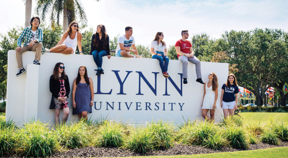 Students by the Lynn sign