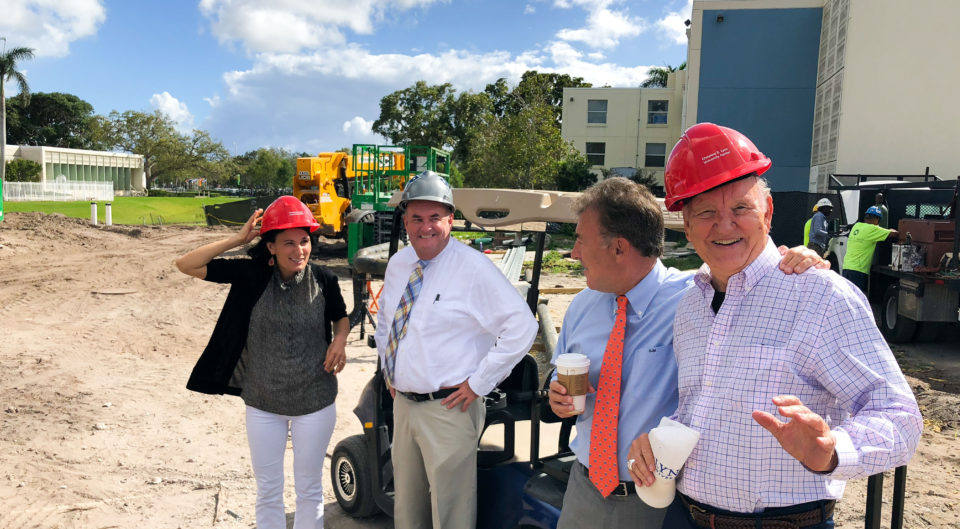 Colleagues visit the future site of the Lynn University Center