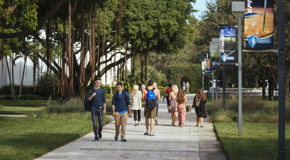 Undergraduate students walking to class on Lynn campus.