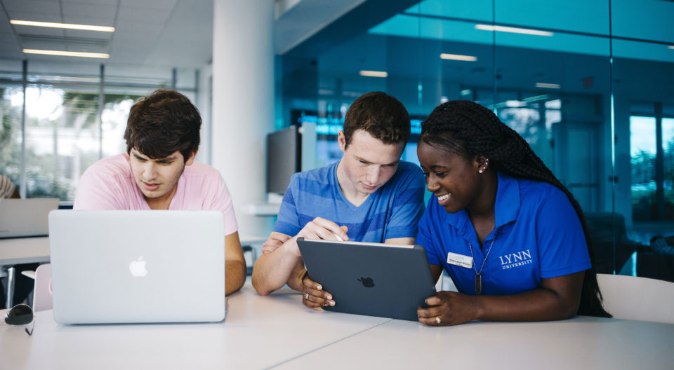 First-year students, undergraduate admission counselors, use iPad Pro on the Lynn University campus.