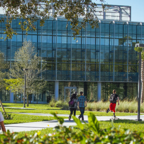 Students walking toward the International Business Center on the Lynn University campus.