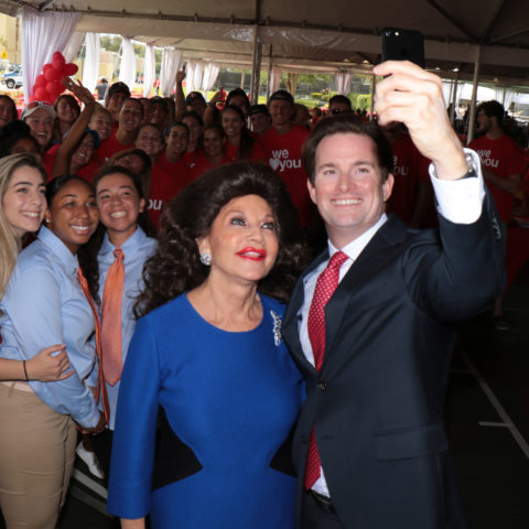 Christine E. Lynn and Kevin Ross take a selfie at the University Center groundbreaking.
