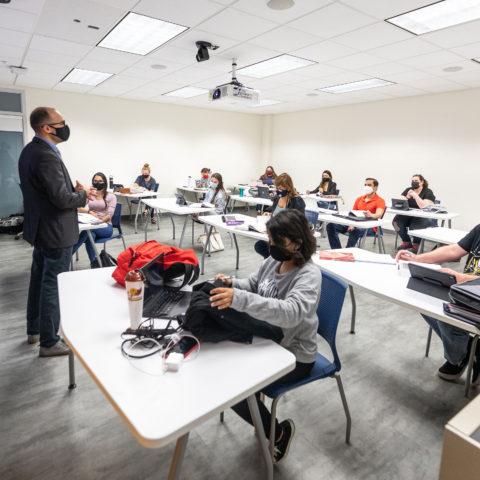 Jon Sperry teaches a classroom of psychology students