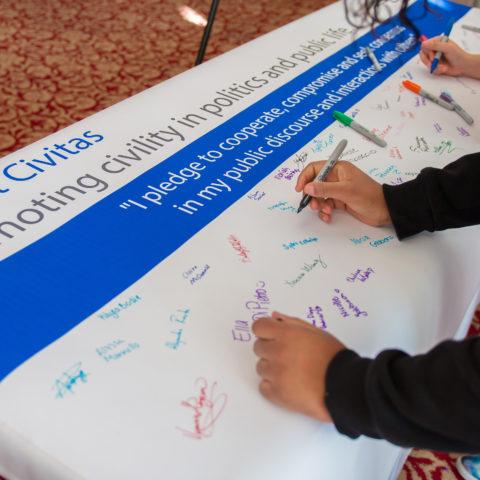 Students sign the Civility Pledge.
