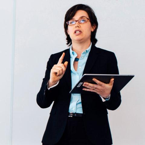 Professor teaching while holding an iPad