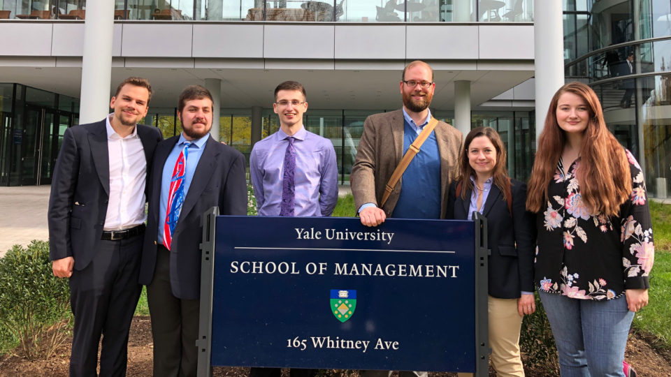 The Lynn University debate team poses in front of Yale University's School of Management.