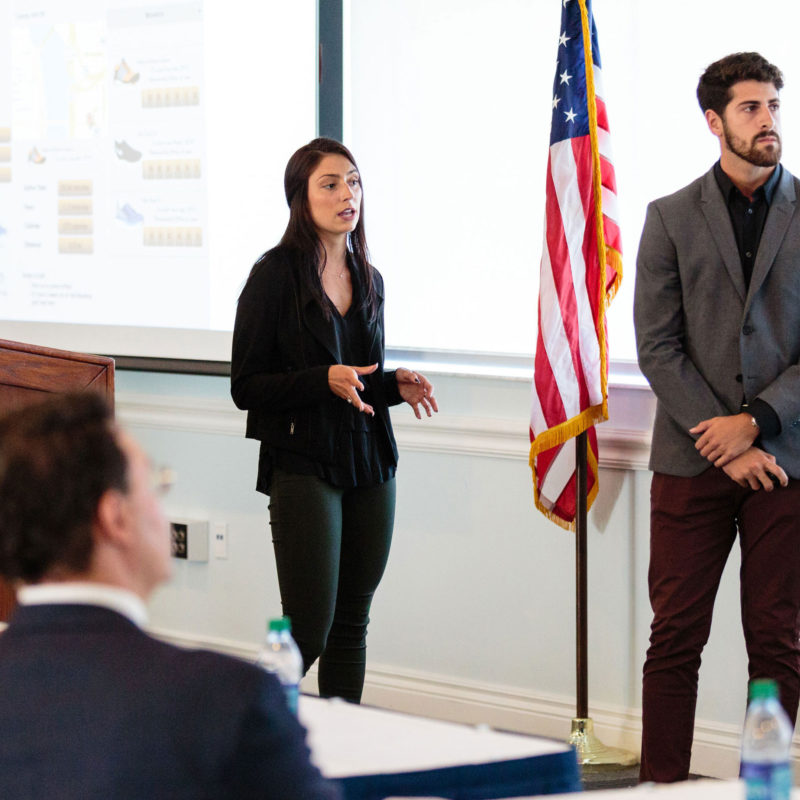 Innovation challenge winners Sydney Parks and Aaron Kleinert pitch their product to judges.
