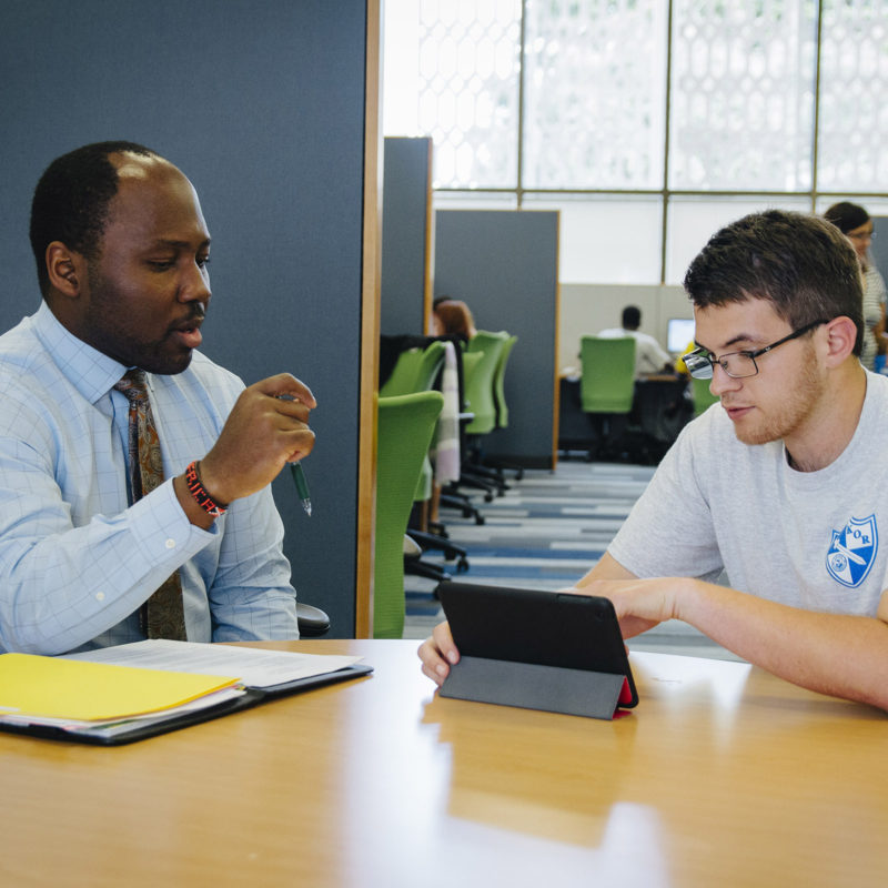 Student talks to advisor in the Institute for Achievement and Learning