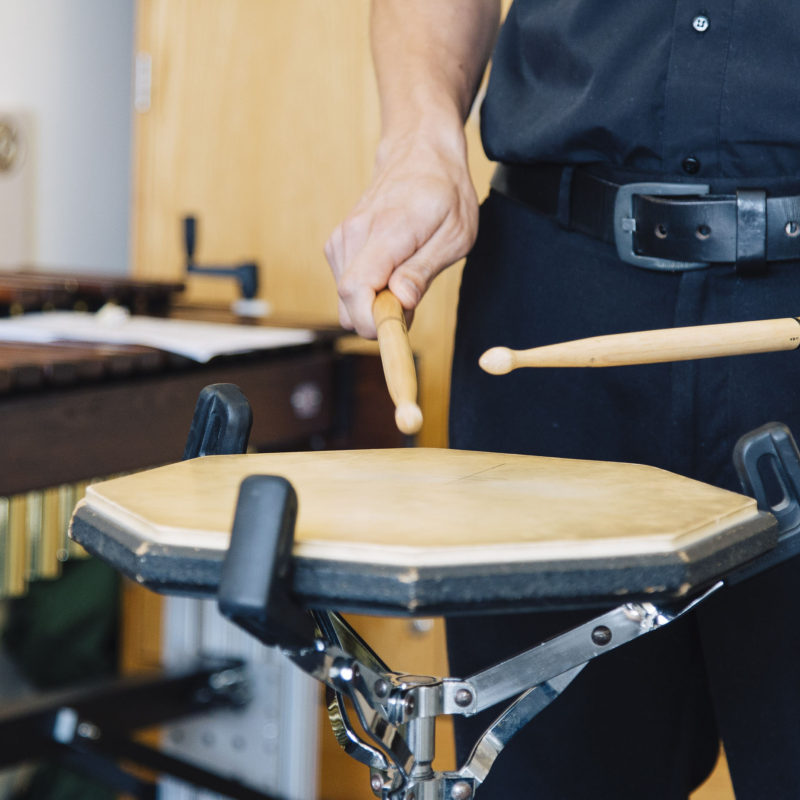 Student plays the drum.