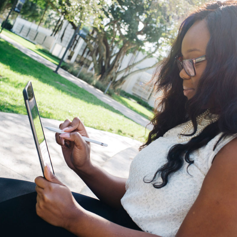 Grad student Nora Emmanuel uses and iPad Pro outdoors