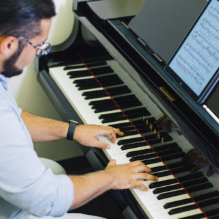 Conservatory student Alfredo plays the piano.