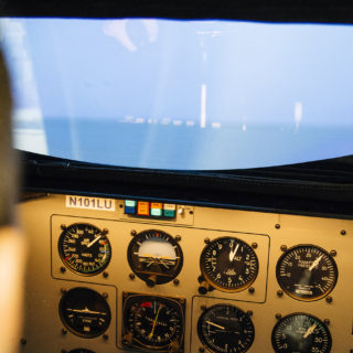 Aeronautics student used flight simulator in commercial pilot training.