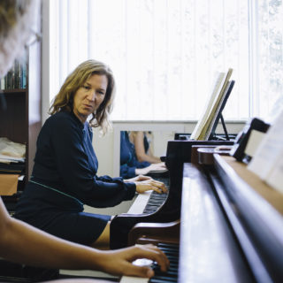 Lisa Leonard instructs student on the piano.